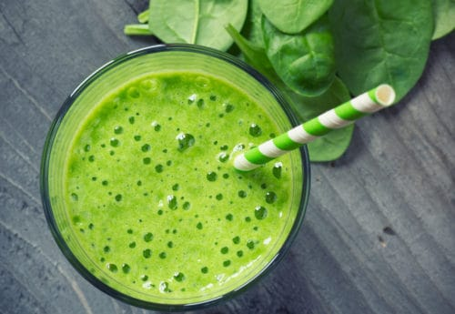 A Green Smoothie With A Straw
