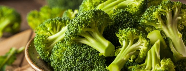 Close up of broccoli stalks in a bowl