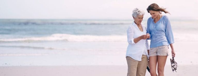 Two Women, Older And Younger On The Beach