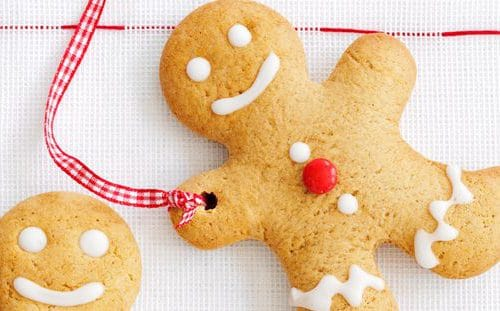 A gingerbread man with a ribbon through it