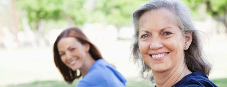 An Older Woman and A Younger Woman Smiling