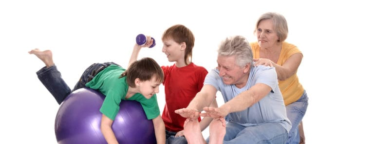 Family members exercising with weights and exercise balls