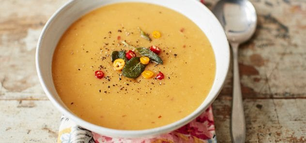 A bowl of pumpkin and parsnip soup with sage and chilli