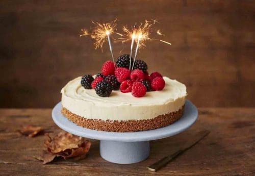 A bonfire night cheesecake with raspberries and blackberries