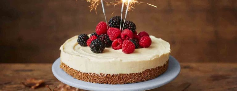 A bonfire night cheesecake with raspberries and blackberries
