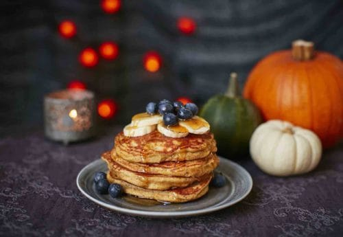 Halloween pancakes with blueberries and bananas