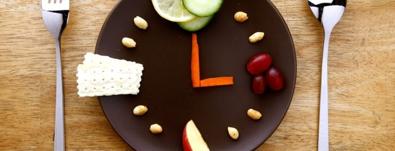 A plate of food in the shape of a clock face