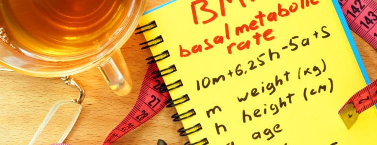 A notepad with BMR or basal metabloic rate written on it
