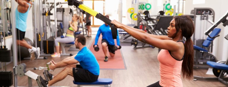 People on Exercise Machines in a Gym