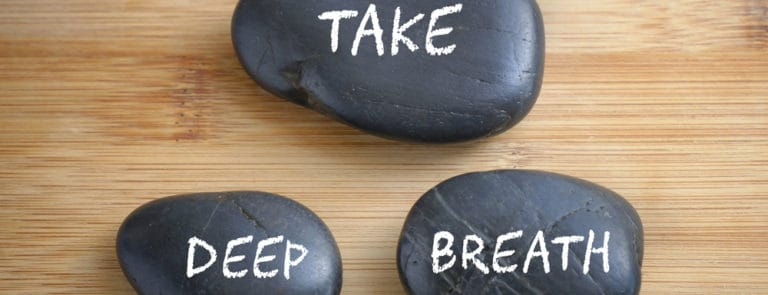 Three pebbles with take deep breath written on them