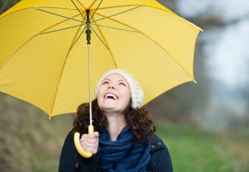 Yellow umbrella woman