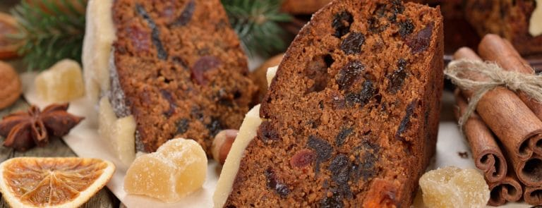 Sliced christmas cake with seasonal decorations