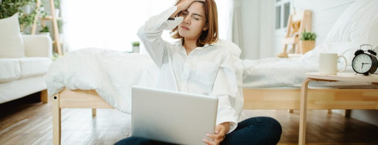 Woman sat on floor on laptop