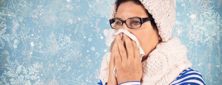 Winter women sneezing