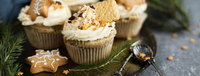 Cupcakes in Christmas style with biscuits and chocolate