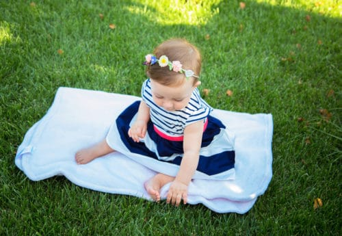 Baby girl sitting on grass