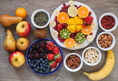 Vegan breakfast: variety of fruits, nuts and berries