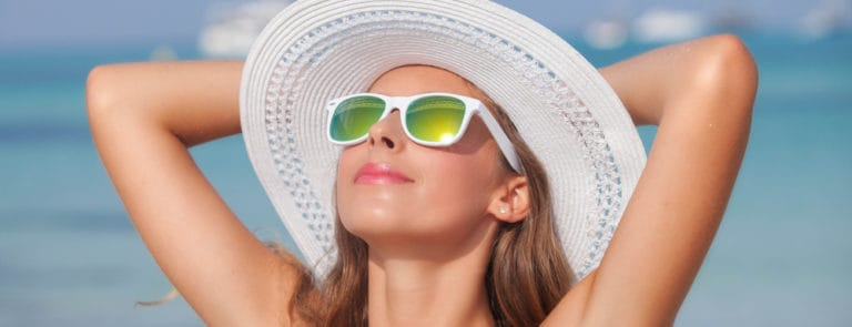 woman with sunglasses sunbathing