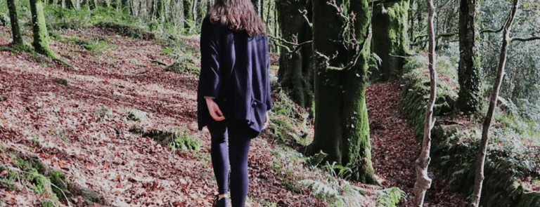 A picture of Madeleine Olivia walking in the woods