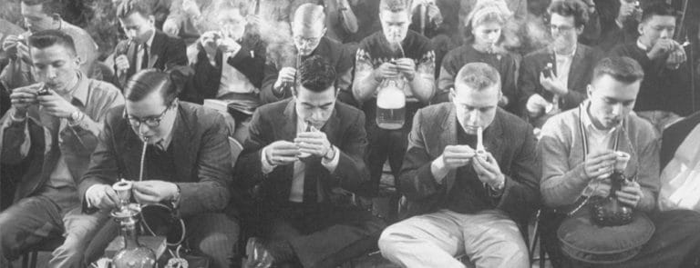 Black and white picture of many men smoking
