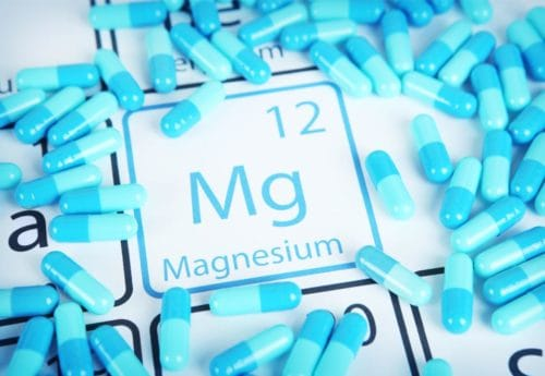 Magnesium symbol surrounded by blue capsules