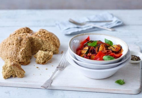 Ratatouille served in a bowl with wholemeal soda bread on the side