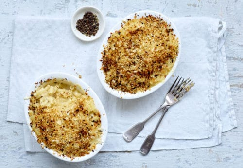 Two portions of macaroni cheese with a chilli and garlic crumb topping