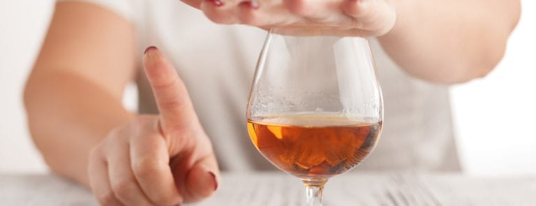 Person saying no to alcoholic drink