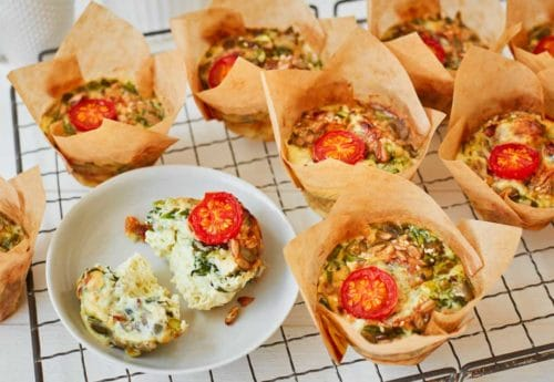 Spinach, asparagus and cherry tomato frittata muffins with mixed seeds