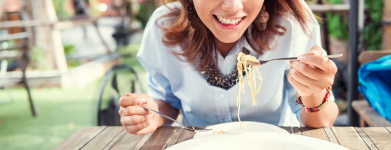 Woman eating spaghetti, good digestion