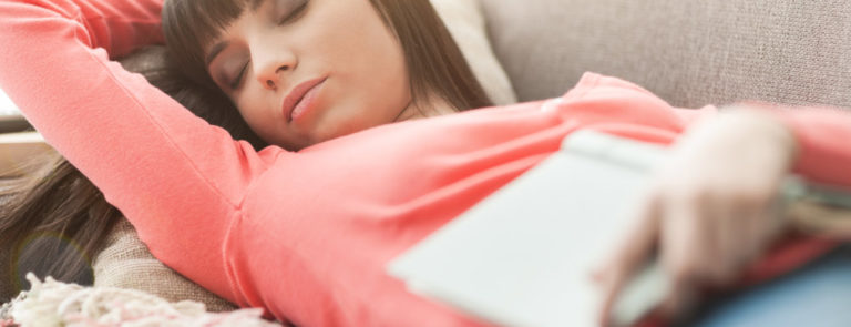 Tired woman napping on sofa