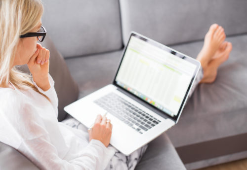 Woman at home self isolating while working from her laptop