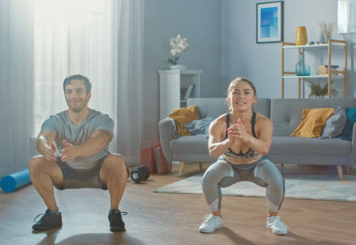 couple working out at home with no equipment