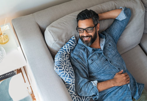 man relaxed holding his stomach with no ibs symptoms