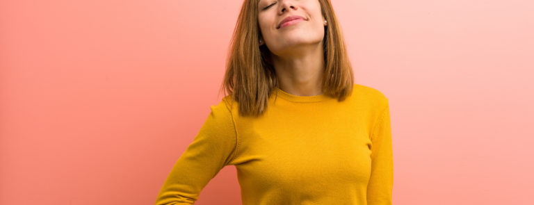 woman happy holding her tummy looking healthy