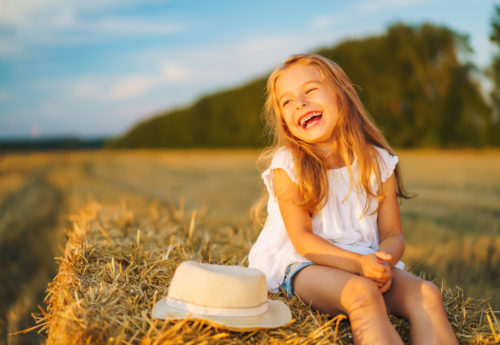 young girl sat in the sun to get vitamin D