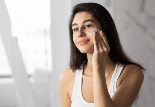 woman taking off makeup to let her skin breathe
