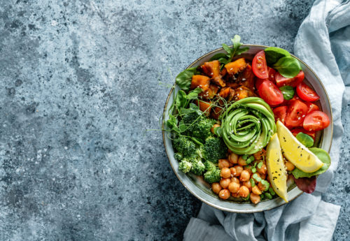 A budda bowl with various vegetables and chickpeas.